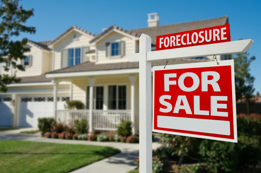 a foreclosure sign on a house