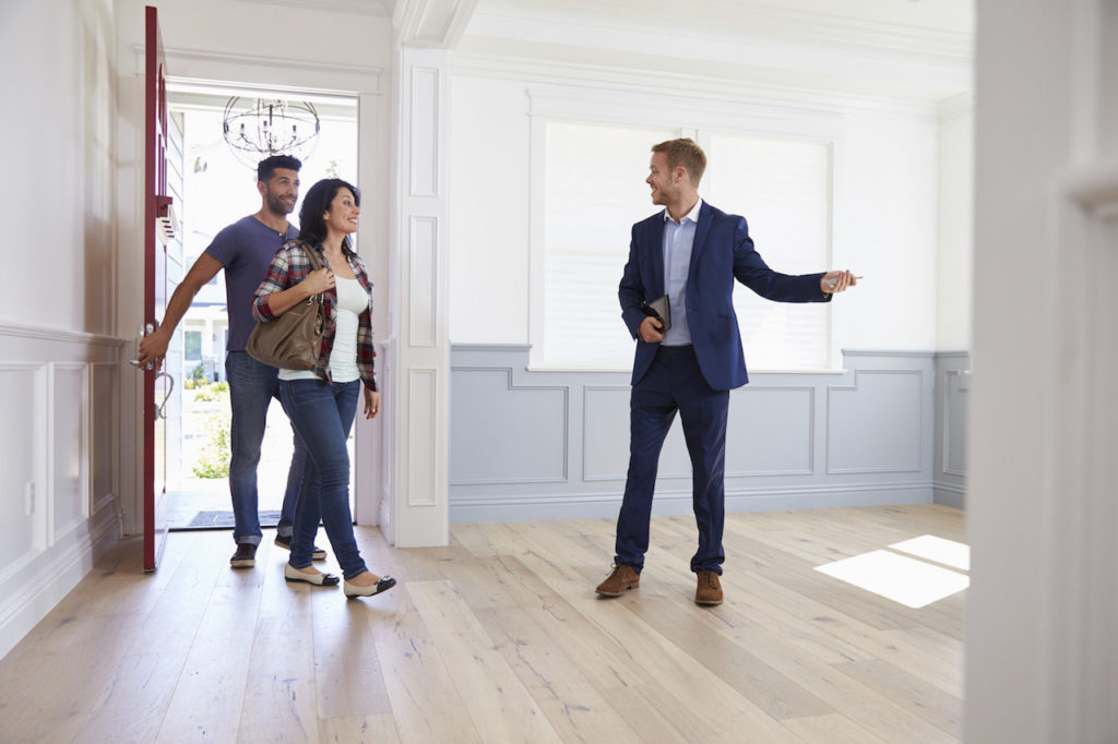 buyers touring a home in summer