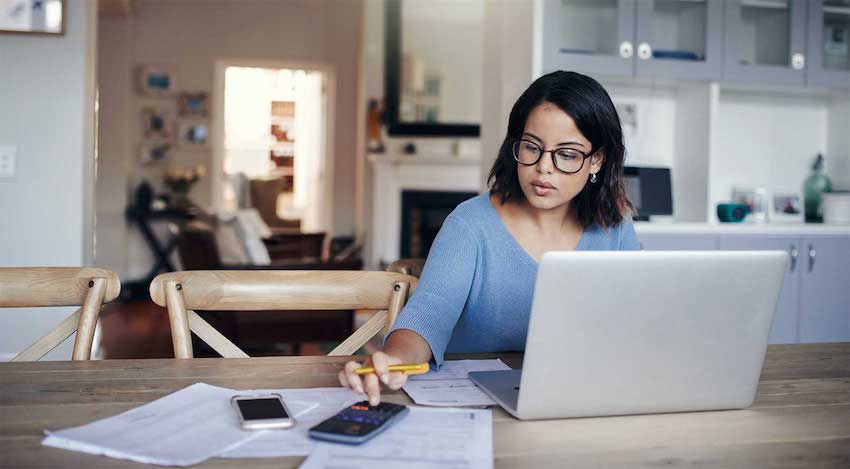 a woman calculating her mortgage